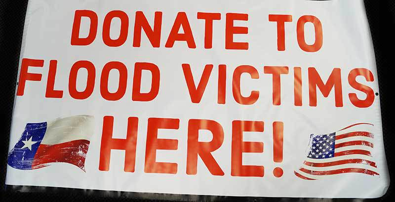 vinyl banner that reads: donate to flood victims